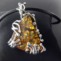 Growing Amber Silver Pendant