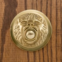 Lion Mouth Doorbell, polished brass